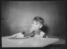 Arthur Rothstein Robstown Texas FSA Farm Security Administration migratory workers' camp. Children are taught to eat fresh vegetables at lunch in nursery school