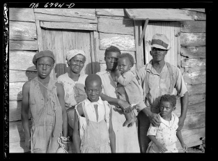Carl Mydans Lewis Hinter Negro client with his family on Ladys Island off Beaufort South Carolina