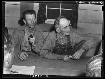 """""""Farm Security Administration (FSA) camp for migratory agricultural workers. Farmersville, California. Meeting of the camp council"""". Dorothea Lange"""