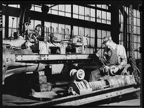 Marion Post Wolcott. Repairing tractor FSA (Farm Security Administration) warehouse depot Atlanta Georgia