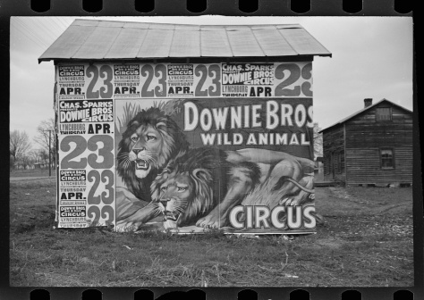 Posters covering a building near Lynchburg to advertise a Downie Bros circus Walker Evans