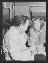 Russell Lee. FSA (Farm Security Administration) dentist reassures migrant child who is making her first visit to a dentist. FSA dental trailer at the FSA camp for farm workers. Caldwell, Idaho