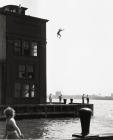 Ruth Orkin, Boy Jumping into Hudson River, 1948, gelatin silver print. The Jewish Museum