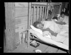 Sick flood refugee in the Red Cross temporary infirmary at Forrest City, Arkansas Walker Evans