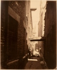 Thomas Annan Plate 18- Close, No. 29 Gallowgate. Bystanders observe Annan as he captures a shadowed alley