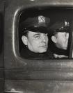 Weegee. New York Patrolman George Scharnikow Who Saved Little Baby, New York, 1938