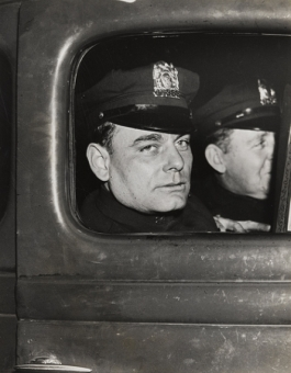 Weegee. New York Patrolman George Scharnikow Who Saved Little Baby, New York, 1938