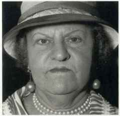 A woman with pearl necklace and earrings, N.Y.C., 1967, Diane Arbus
