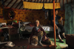 """Like their ancestors before them, herders Janiyansuren and Chantsal have been nomads all their lives. Even though the family herds have been decimated by the dzud (""""winter disaster""""), they will remain on the steppe while most of their children have moved to the city."""