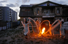 Nomad Wave women's art collective perform part of an installation piece at the former summer residence of Bogd Khan, the last emperor of Mongolia. The linked sleeves of their garments represents unity and sisterhood, but also forms a ring of protection against the fear of the tiny Mongolia being lost in face of Chinese and Western globalization.