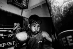 Al-Amin practices boxing in the Mohammad Ali Boxing stadium every day. Dhaka, Bangladesh.
