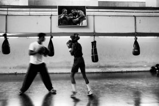 A group of boys practices boxing in the BKSP Boxing stadium every day. Dhaka, Bangladesh.