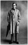 irving_penn_oscarenfotos_cecil-day-lewis-poet-wearing-a-three-button-checked-overcoat-hands-in-the-pockets-with-an-umbrella-c2a9-condc3a9-nast-photo-by-irving-penn-from-the-book-nostalgia-in-vogue
