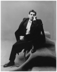 irving_penn_oscarenfotos_leonard-bernstein-conductor-and-composer-wearing-a-tuxedo-sitting-on-a-group-of-carpeted-boxes-condc3a9-nast-photo-by-irving-penn-from-the-book-nostalgia-in-vogue