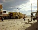 Stephen Shore. 2nd Street East and South Main Street, Kalispell, Montana (August 22, 1974