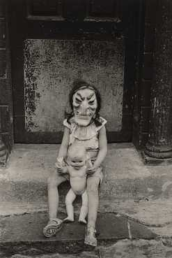 Masked Child with a Doll, N.Y.C., 1961