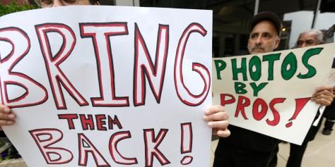 Protesta contra el Chicago Sun Times después de que despidió a todos sus fotógrafos de planta. Foto cortesía The Huffington Post