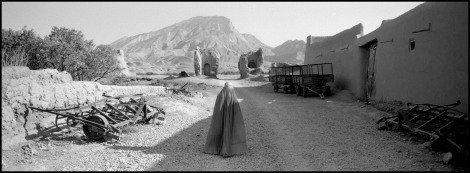 AFGHANISTAN. 2008. Tashquran village, Hilltop. Woman in burqua amid ruins. Village destroyed in the line of fire between Russian troops and the Mujahadeen, Afghanistan has known only invasion and civil war for the past 30 years.