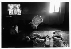 MEXICO. La Batea, Zacatecas. 1992. Mennonite girl sitting at a table.