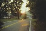 El sol en el camino Shandoke, New York, 1983.