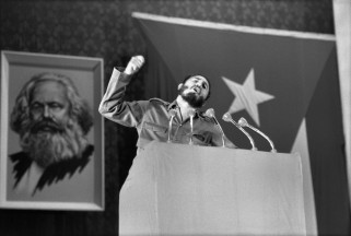 CUBA. Havana. 1963. Fidel CASTRO speaks on reorganization of the party. He displays telegrammes of MALINOWSKI (Soviet Minister) and of MAC NAMARA (US Secretary of Defense). Photographed after three hours of speaking at the Teatro Chaplin.
