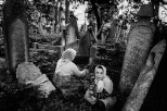 TURKEY. 1985. Children playing among the tombstones in the Seyhülislam Yahya Efendi cemetery at Ortaköy.