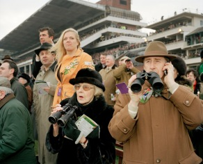 GB. ENGLAND. The Cheltenham Gold Cup. Spectators watching the horse races in Cheltenham. 2006. Contact email: New York : photography@magnumphotos.com Paris : magnum@magnumphotos.fr London : magnum@magnumphotos.co.uk Tokyo : tokyo@magnumphotos.co.jp Contact phones: New York : +1 212 929 6000 Paris: + 33 1 53 42 50 00 London: + 44 20 7490 1771 Tokyo: + 81 3 3219 0771 Image URL: http://www.magnumphotos.com/Archive/C.aspx?VP3=ViewBox_VPage&IID=29YL534JE4QN&CT=Image&IT=ZoomImage01_VForm