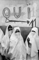 "ALGERIA. Algiers. The conflict with France and Algeria has lasted for 8 years, splitting the French Colonial powers who wanted to retain an ""Algerie Francaise"" and the local population led by the FLN (National Liberation Front) who demanded independence. Veiled women going to the voting stations for the Independence referendum. July 1962."
