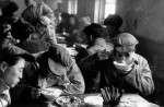 CHINA. Liaoning province. Town of Anshan. 1957. Large steel mill built by the Soviets near important iron deposits. In the factory canteen engineers have lunch whilst keeping their protective glasses on. As in the rest of China, it is hard to distinguish the engineers from the factory workers.