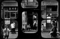 CHINA. 1965. A street in Beijing as seen from inside an antique dealer's shop.