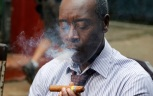 """In this Jan. 15, 2016 photo """"House of Lie""""s actor Don Cheadle smokes a cigar outside the Bodeguita Del Medio bar during a shoot of an episode in Havana, Cuba. Producers of """"House of Lies"""" and other productions shot in Cuba said the 55-year-old U.S. trade embargo on Cuba posed the primary obstacle to U.S. entertainment companies' hopes to the island into a tropical backdrop. But particularly Cuban difficulties could also prevent U.S. productions from regularly working on the island. (AP Photo/Desmond Boylan)"""
