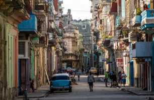 People walk along the streets of downtown Havana, Cuba, Sunday, Nov. 27, 2016. Fidel Castro, who led a rebel army to improbable victory in Cuba, embraced Soviet-style communism and defied the power of U.S. presidents during his half century rule, died at age 90 on Friday night. (AP Photo/Desmond Boylan)