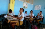 Carmen Gonzalez (near C) sits in her classroom a few days before her quinceanera (coming-out for 15-year-olds) celebration, in Havana, January 9, 2013. As nearly all Cuban girls dream of having a quinceanera, the industry that moves around that dream is large, with clients ranging from wealthy Cuban-Americans who travel back to the island to sponsor lavish parties, to regular Cubans who save a few hundred dollars over several years from their monthly $18 state wage. Picture taken January 9, 2013. REUTERS/Desmond Boylan (CUBA)