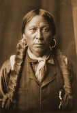 A portrait of a Jicarilla Apache man, as photographed by Edward Sheriff Curtis circa 1904. Made from a color film copy transparency.